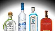 Bottles of Patrón, Grey Goose, Bombay Sapphire, and Woodford Reserve available at Penthouse Club in New Orleans, LA