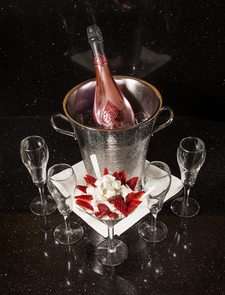 Bottle of Moët Champagne on ice with champagne glasses at Penthouse Club in New Orleans, LA